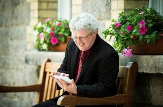 RW smiling with iPad mini outdoors