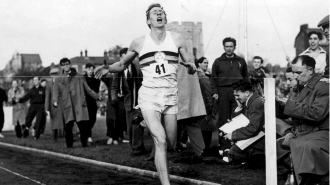 Roger Bannister completing the first sub 4 minute mile.